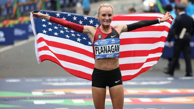 Shalane Flanagan became the first American to win the female race of the New York City Marathon since 1977.  She is shown here after crossing the finish line in Central Park, Sunday, Nov. 5, 2017.