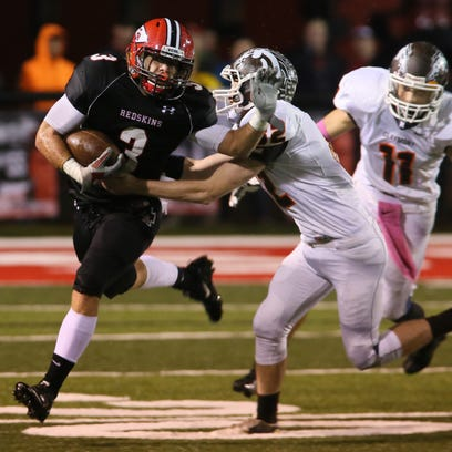Coshocton senior Dallas Griffiths carries the ball