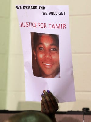 This Dec. 8, 2014, file photo shows a sign with a picture of Tamir Rice during a news conference in Cleveland.