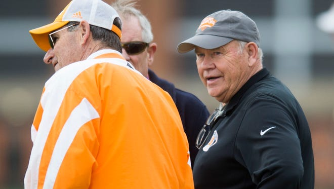 At right University of Tennessee athletic director Phillip Fulmer watches during a University of Tennessee football practice Tuesday, March 27, 2018.