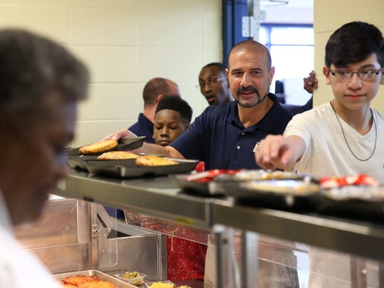 Superintendent Rocky Hanna goes through the lunch line at the Augustus Raa Middle School cafeteria Monday. Hanna was an eighth-grader at Raa 40 years ago.