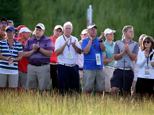 The crowd cheers the shot of Jordan Niebrugge of Wisconsin after he is the first to tee off on hole No. 1 during the opening round of the 2017 U.S. Open Championship at Erin Hills.