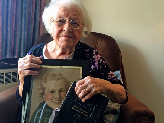 Virginia Rosinsky, 99, poses with a portrait of herself