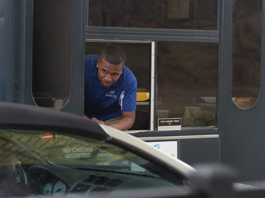 Reginald Minter, a Memphis resident and TSU student, works as a cashier at Nashville International Airport long term parking on Saturday, Dec. 31, 2016.  Minter's mentor helped get him a job at the parking company at the Nashville airport.