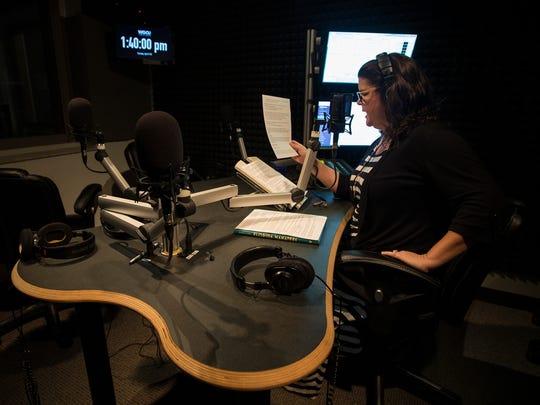 Julie Glenn, host of the WGCU radio show Gulf Coast Live, rehearses a reading during a break Tuesday afternoon.