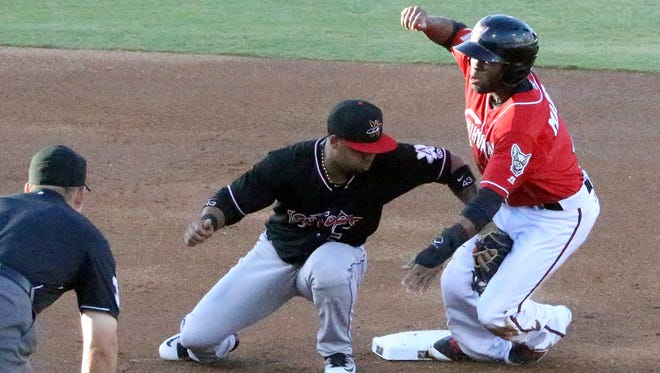 Manuel Margot, right, of the El Paso Chihuahuas gets the second base steal just before Albuquerque Isotopes shortstop Rafael Ynoa could tag him Thursday night at Southwest University Park. Margot went on to score the first run for the Chihuahuas.