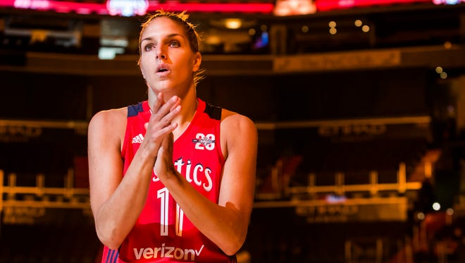 Washington's Elena Delle Donne looks into the stands as she stands at center court during pregame introductions before the start of the Washington Mystic's season opening game against the San Antonio Stars at the Verizon Center in Washington, D.C. on Sunday afternoon.