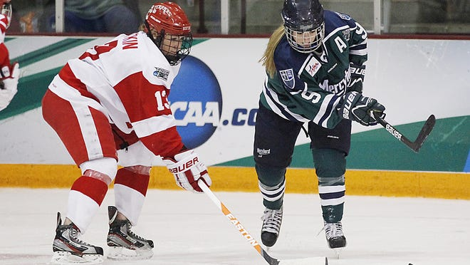 Former Boston University defender Kaleigh Fratkin (left), now a member of the Boston Pride, fights for the puck against Mercyhurst forward Kelsey Welch in the semifinals of the women's Frozen Four NCAA college hockey tournament on March 22, 2013, in Minneapolis. Boston won 4-1.