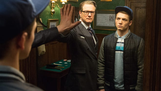 "Colin Firth, left, and Taron Egerton enter a super spy agency in ""Kingsman: The Secret Service."""