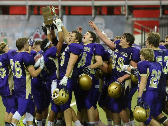 The Winner Warriors celebrate their 45-6 win over Tri-Valley in Friday's class 11B football championship at the DakotaDome in Vermillion, Nov 13, 2015.