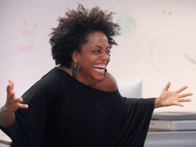Rhonda Ross Kendrick gives a lecture to a group of