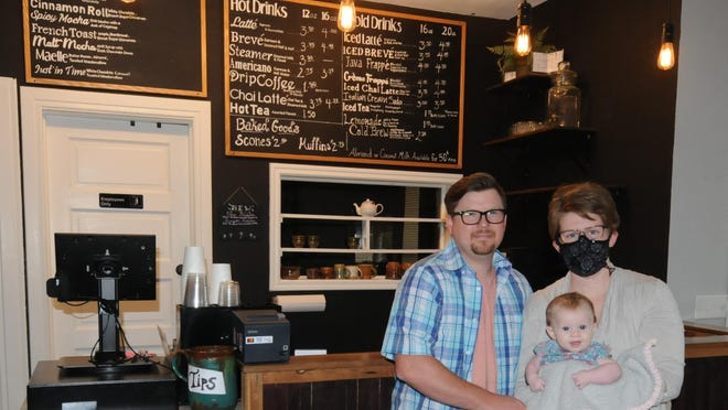 Leaders of the North Central Kansas Teens for Christ organization Shad and Amber Clark stand with their 5-month-old baby, Annabelle, inside the Common Grounds Coffeehouse, 104 E. 7th St. in Concordia. The NCK-TFC is currently working to raise money to purchase the building for a place where teens, family members and college students can meet regularly to have Bible studies, game nights, worship nights, classes and tutoring.