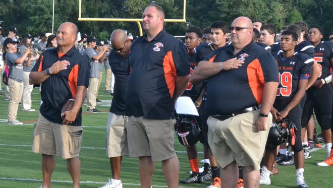 First-year coach Mike Lindberg (center) earned his first win against Mount Vernon behind a 361-yard day from running back Glenmour Osbourne.
