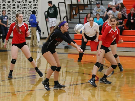 Canton's Alexis Granowicz (No. 17) bumps the ball Monday,