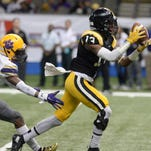 Neville's Quintin Guice pulls in a long pas over Edna Karr's  Leonte Harris for a touchdown in the first quarter of the state championship game.