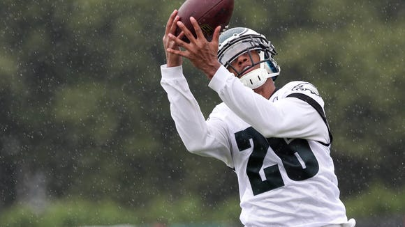 Jul 26, 2014; Philadelphia, PA, USA; Philadelphia Eagles cornerback Cary Williams (26) catches the ball during training camp at the Novacare Complex in Philadelphia PA. Mandatory Credit: Bill Streicher-USA TODAY Sports