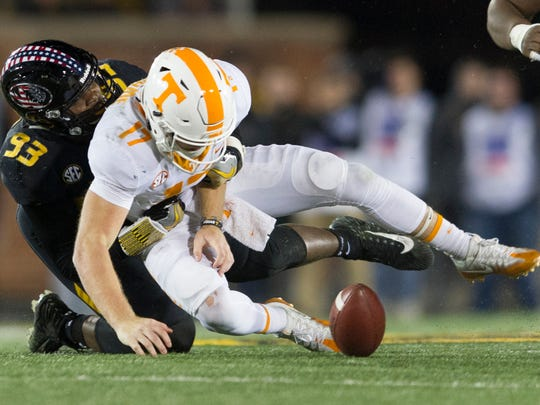 Tennessee quarterback Will McBride (17) is sacked by Missouri defensive lineman Tre Williams (93) during a game between Tennessee and Missouri at Faurot Field in Columbia, Missouri, on Saturday November 11, 2017.