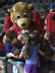 Good Shepherd Catholic School students offer a group hug to Evan the Otter during a break in the action of the final Evansville Otters exhibition game against Florence Freedom at Bosse Field in Evansville Wednesday. Hundreds of area kids attended the game and the Otters have their season opener at Bosse Field Friday.