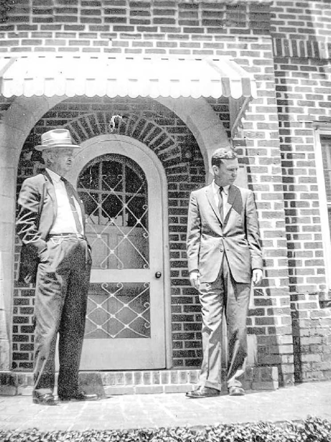 T.S. Green, left, stands with one of his sones, T.S. Green Jr., in front of his home at 228 E. Tharpe St., circa 1960. Green developed the nearby Sunniland neighborhood in the 1920s and 1930s.