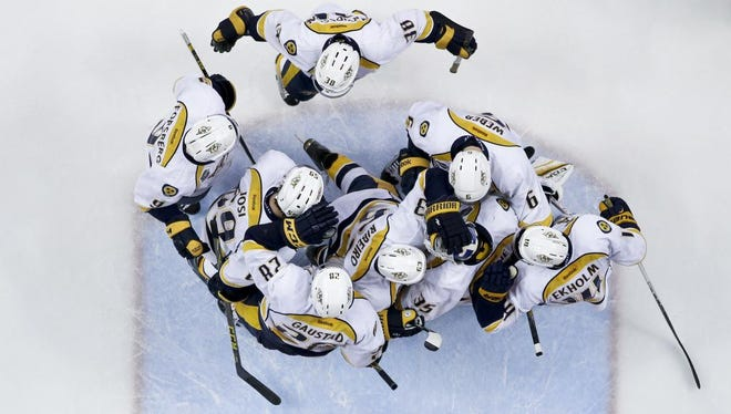 The Predators celebrate after winning 3-2 in Game 2 of their first round playoff series against the Ducks at Honda Center in Anaheim.
