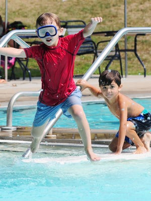 In this 2015 file photo, children play at the Glen Ridge Community Pool, among a number of places people can cool off as temperatures soar.