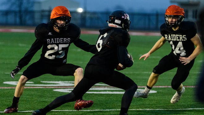 Southridge's Jacob Masterson (25) attempts to stop Patrick Sander (6) from running the ball during a practice at Southridge High School in Huntingburg, Ind., Wednesday, Nov. 15, 2017. Their team will face No.2 Indianapolis Scecina in the Class 2A semi-state game be held on Saturday at 1 p.m. CST at Indianapolis Tech.