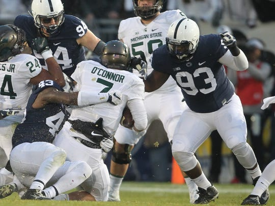 Penn State linebacker Manny Bowen, 43, brings down Michigan State quarterback Tyler O'Connor in 2016. YORK DISPATCH FILE PHOTO