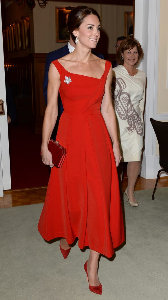 Duchess Kate donned a scarlet Preen midi gown for a reception in Victoria at the end of Day 3 of the Canada tour.