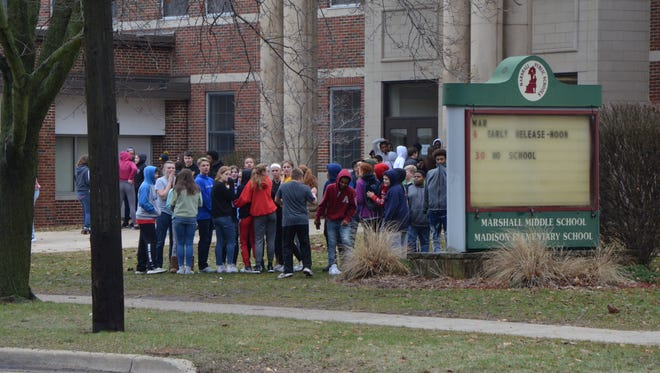 The students protested outside of their school for at least two hours Wednesday.