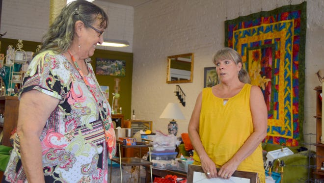Marilyn Goble, left, and Debbie Troyer chat at Silver Whisker Thrift Store 118 S. Silver Avenue. The high-end thrift store is run by the Deming Animal Guardians, the nonprofit organization.