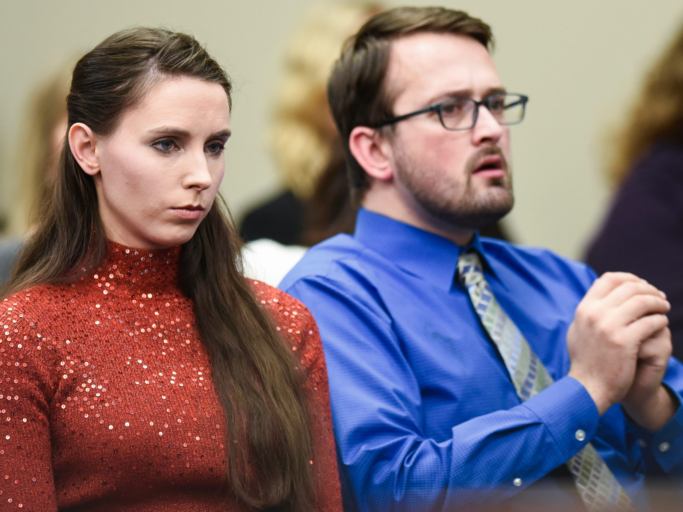 Rachael and Jacob Denhollander listen to victim impact statements on Monday, Jan. 22, 2018, the fifth day of Larry Nassar's sentencing hearing in Ingham County Circuit Court. Denhollander's August 2016 report began the investigation that ended with more than 200 victims.