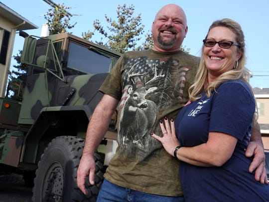 Jack McLain and Jorja Moore of Howell pose with their surplus US Army truck in front of Woody's. Woody's Tavern in Farmingdale didn't show football on Sunday in respect for veterans on Veterans Day weekend. In place of the games, the bar will hold a special concert featuring members of the New Jersey-based country group After the Reign, with a portion of the proceeds going to the Green Beret Foundation through Special Forces Association Chapter 19. Farmingdale, New Jersey. Sunday, November 12, 2017. David Gard