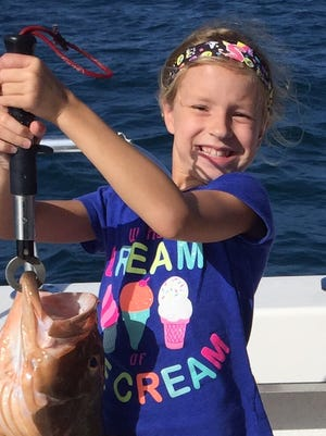 Siena Bammel, 8, caught this 16-pound grouper on the Alabama fishing charter in Naples. The grouper was caught in the Gulf of Mexico about 30 miles offshore, using cut bait.