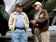 World War II Air Force B-17 veterans William Toombs, former Tech Sergent, left and Ike Farrar, former pilot, right talk under the shadow of the Memphis Belle.