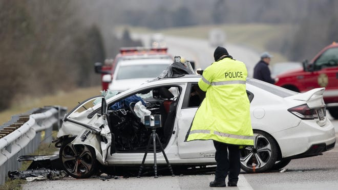 FILE - In this Saturday, Jan. 25, 2020, file photo, emergency crews work the scene of a fatal crash involving a charter bus and car on the AA highway in Campbell County, Ky. The driver of the vehicle died. The number of people killed on the nation's highways rose 4.6% in the first nine months of 2020, despite coronavirus lockdowns that curtailed driving early in the year.
