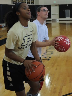 Ryan Steele gets pointers on his jump shot from senior guard April Wilson Sunday afternoon as Purdue hosted its first 'Play Unified' tournament with Special Olympics.
