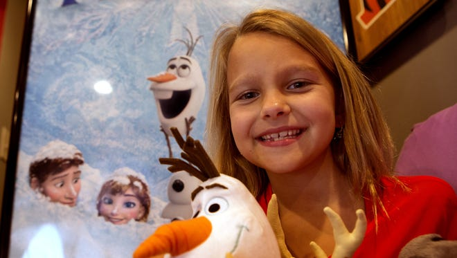 """Livvy Stubenrauch shown here with stuffed characters from """"Frozen"""" in 2013."""