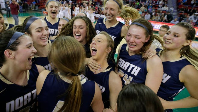 Appleton North players celebrate their victory against De Pere for the WIAA Division 1 State Tournament girls basketball title on Saturday, at the Resch Center.