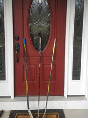 At the Wyckoff home of Northern Highlands hockey coach Jason Beswick, 11-year-old Brent left sticks outside the front door in remembrance of the 15 members of the Humboldt Broncos junior hockey program who were killed in a bus accident in Saskatchewan last Friday.