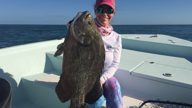 Tripletail were the catch of the day Sunday for Jenny Myers, who was fishing north of Fort Pierce Inlet.