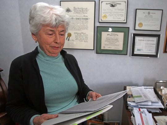 Carolyn Cunningham is a longtime environmental advocate who fought hard to keep Westchester County Airport from getting too big was photographed in her home in Rye on Dec. 15, 2016. Cunningham's experiences battling the county led her to go to Pace Law School at the age of 50 to study environmental law.