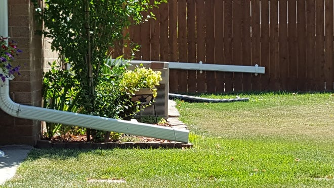 The location of downspouts and permeable surfaces on lots like these in a Milwaukee neighborhood can have a major impact on how much storm water is absorbed into the ground.