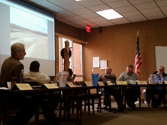 Phil King, left, consultant water engineer for Elephant Butte Irrigation District, addresses the EBID board on Thursday at the district's headquarters in Las Cruces. So far this winter, snowpack in the Rocky Mountains is leading to Mesilla Valley farmers being optimistic for a good water year, he said.