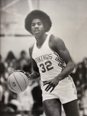 """Earvin """"Magic"""" Johnson playing in a Lansing Everett High School game, 1977."""
