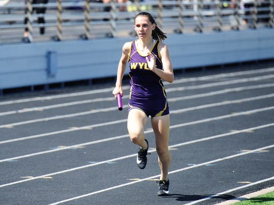 Wylie's Abbey Henson runs the third leg of the girls mile relay final during the District 5-4A meet at Bulldog Stadium on Thursday, April 5, 2018. Henson helped the Lady Bulldogs win the race and qualified as an individual in the 400.