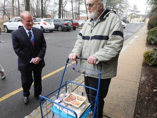 Here, Rep. Leonard Lance delivering food as part of