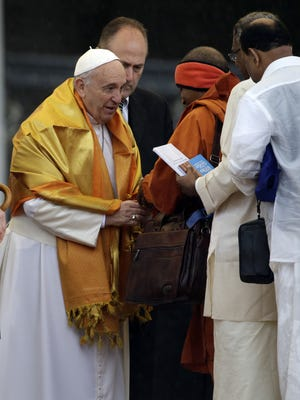 Pope Francis meets the faithful during his weekly general audience in St. Peter's Square at the Vatican on Wednesday.
