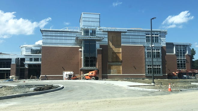 """This outside view of the back/student entrance to the new Middleborough High School building looks to be nearing completion. Inside, finish work in underway and some areas within the building have been """"powered up,"""" according to Building Commmittee Chairman Rob Desrosiers."""
