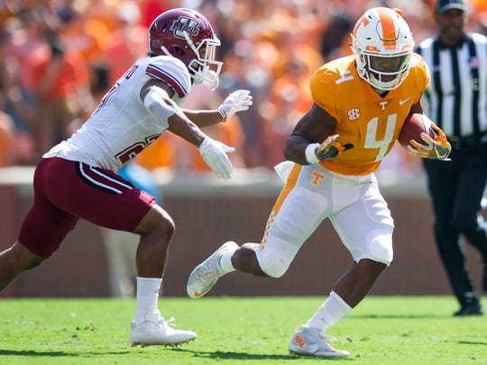 Tennessee running back John Kelly (4) runs down field during Tennessee's game against UMass in Neyland Stadium on Saturday, Sept. 23, 2017.