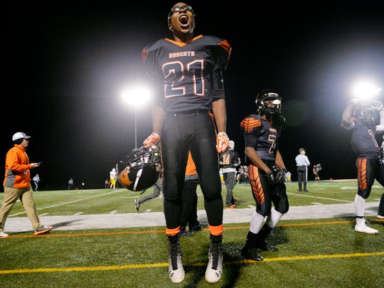 Northeastern's Michael Cooper celebrates on the sideline during the final seconds of the Bobcats' 48-12 victory against Northern Lebanon in the first round of the District 3 Class AAA playoffs last Friday.